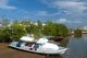 Once a simple fishing harbor, Krabi is becoming an eco-tourism center, as well as the main ferry embarkation point for islands such as Ko Lanta to the south, Ko Phi Phi to the southwest, and the beaches around Ao Nang to the west.<br/><br/>  Set on the banks of the Krabi Estuary, the town is said to take its name from a sword or krabi allegedly discovered nearby. Krabi's surroundings are distinguished by towering limestone outcrops, a kind of Phang Nga Bay on land, and these have become the symbol of Krabi Province. Among the most notable are Khao Khanap Nam, twin limestone peaks, which stand like sentinels at each side of the Krabi River. To the east, the town is hemmed in by mangrove-lined shorelines.